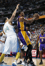Los Angeles Lakers center Andrew Bynum, right, goes up for a shot as Denver Nuggets center JaVale McGee defends in the first quarter of Game 6 of a first-round NBA  basketball playoff series, in Denver on Thursday, May 10, 2012. (AP Photo/David Zalubowski)