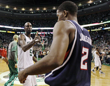 Boston Celtics power forward Kevin Garnett (5) shakes hands with Atlanta Hawks shooting guard Joe Johnson (2) after Game 6 in a first-round NBA basketball playoff series in Boston, Thursday, May 10, 2012. The Celtics won 83-80 and won the series 4-2 to advance to the second round. (AP Photo/Charles Krupa)