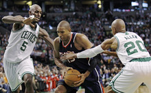 Atlanta Hawks center Al Horford, center, is trapped by Boston Celtics power forward Kevin Garnett (5) and guard Ray Allen (20) on a drive to the basket during the second quarter of Game 6 in a first-round NBA baskettball playoff series in Boston, Thursday, May 10, 2012. The Celtics won 83-80 and won the series 4-2 to advance to the second round. (AP Photo/Charles Krupa)