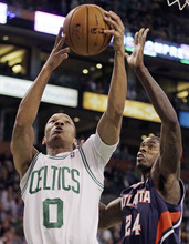 Boston Celtics shooting guard Avery Bradley (0) drives to the basket against Atlanta Hawks small forward Marvin Williams (24) during the first quarter of Game 6 in a first-round NBA basketball playoff series in Boston, Thursday, May 10, 2012.  (AP Photo/Charles Krupa)