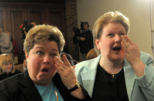 FILE- This Friday April 3, 2009, file photo, shows Trish Varnum, left, and Kate Varnum, of Cedar Rapids, Iowa, after hearing the Iowa Supreme Court legalize same-sex marriage, in Des Moines, Iowa. Americans reacted with joy, scorn and indifference to Obama's words in a television interview on Wednesday, May 9, 2012, announcing that he supports gay marriage. (AP Photo/Steve Pope, File)