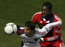 Real Salt Lake's Emiliano Bonfigli, left, keeps the ball away from Chicago Fire's Jalil Anibaba during the second half of an MLS soccer game on Wednesday, May 9, 2012, at Toyota Park in Bridgeview, Ill. The game ended in a 0-0 tie. (AP Photo/John Smierciak)