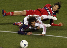 Chicago Fire's Sebastian Grazzini, top, and Real Salt Lake's Kyle Beckerman go down after colliding during the second half of an MLS soccer game on Wednesday, May 9, 2012, at Toyota Park in Bridgeview, Ill. The game ended in a 0-0 tie. (AP Photo/John Smierciak)