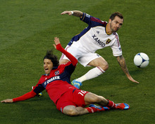 Real Salt Lake's Jonny Steele, right, trips up Chicago Fire's Sebastian Grazzini, left, during the first half of an MLS soccer game on Wednesday, May 9, 2012, at Toyota Park in Bridgeview, Ill. The game ended in a 0-0 tie. (AP Photo/John Smierciak)