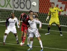 Chicago Fire's Austin Berry (22) tries but misses a header during the second half of an MLS soccer game against Real Salt Lake, Wednesday, May 9, 2012, at Toyota Park in Bridgeview, Ill.  The game ended in a 0-0 tie. (AP Photo/John Smierciak)