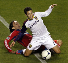Chicago Fire's Rafael Robayo, left, comes down on the legs of Real Salt Lake's Tony Beltran, right, during the second half of an MLS soccer game on Wednesday, May 9, 2012, at Toyota Park in Bridgeview, Ill. The game ended in a 0-0 tie. (AP Photo/John Smierciak)