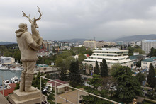 In this photo taken on Thursday, May 19, 2011, an old Soviet style statue of a reindeer breeder, left, is seen over the Black Sea resort of Sochi, southern Russia. Russia's secret service said Thursday, May 10, 2012, that it had foiled terror attack plans in the Black Sea resort of Sochi ahead of the 2014 Winter Games. The FSB said it suspects the attacks were being masterminded by Doku Umarov. The FSB also said that it suspects that Umarov has close links to the secret service in Georgia. (AP Photo/Alexander Zemlianichenko, file)