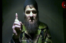 This image taken from video and released Monday, Feb. 7, 2011 by The Kavkaz Center, a website affiliated with Chechen rebels, shows insurgent leader Doku Umarov speaking in a video. Russia's secret service said Thursday, May 10, 2012, that it had foiled terror attack plans in the Black Sea resort of Sochi ahead of the 2014 Winter Games. The FSB said it suspects the attacks were being masterminded by Umarov. (AP Photo/The Kavkaz Center) NO SALES