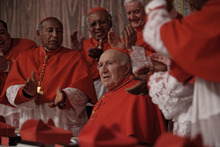 Michel Piccoli (center) plays Cardinal Melville, who is taken aback when his fellow Cardinals elect him Pope, in