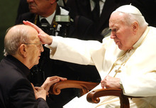 FILE  - In this Nov. 30, 2004 file photo,  Pope John Paul II gives his blessing to late father Marcial Maciel, founder of Christ's Legionaries, during a special audience the pontiff granted to about four thousand participants of the Regnum Christi movement, at the Vatican.The Vatican is investigating seven priests from the troubled Legion of Christ religious order for alleged sexual abuse of minors and another two for other alleged crimes, The Associated Press has learned. The investigations mark the first known Vatican action against Legion priests for alleged sexual assault following the scandal of the Legion's founder, who was long held up as a model by the Vatican despite credible accusations _ later proven _ that he raped and molested his seminarians. The Legion, which is now under Vatican receivership, has insisted that the crimes of its late founder, the Rev. Marciel Maciel, were his alone. (AP Photo/Plinio Lepri, File)