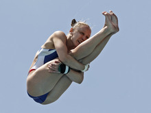 Katherine A. Bell, of the United States,  performs during the women's 10-meter platform preliminaries at the USA Diving Grand Prix in Fort Lauderdale, Fla., Friday, May 11, 2012. (AP Photo/Alan Diaz)