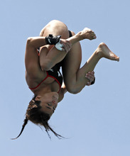 Meaghan Benfeito, of Canada, performs during the women's 10-meter platform preliminaries at the USA Diving Grand Prix in Fort Lauderdale, Fla., Friday, May 11, 2012. (AP Photo/Alan Diaz)
