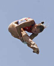 Brittany A. Viola, of the United States, performs during the women's 10-meter platform preliminaries at the USA Diving Grand Prix in Fort Lauderdale, Fla., Friday, May 11, 2012. (AP Photo/Alan Diaz)