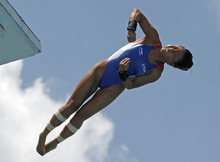 Haley D. Ishimatsu, of the United States, performs during the women's 10-meter platform preliminaries at the USA Diving Grand Prix in Fort Lauderdale, Fla., Friday, May 11, 2012. (AP Photo/Alan Diaz)