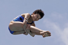 Huixia Liu, of China, performs during the women's 10-meter platform preliminaries at the USA Diving Grand Prix in Fort Lauderdale, Fla., Friday, May 11, 2012. (AP Photo/Alan Diaz)
