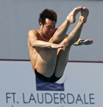 Ken Nee Youh, of Malaysia, performs during the men's three-meter springboard preliminaries at the USA Diving Grand Prix in Fort Lauderdale, Fla., Friday, May 11, 2012. (AP Photo/Alan Diaz)