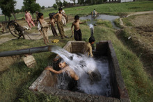 Pakistani boys swim in a water reservoir to cool off as the temperature rises, on the outskirts of Gujranwala, in Punjab province, Pakistan, Thursday, May 10, 2012. (AP Photo/Muhammed Muheisen)