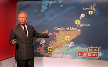 Britain's Prince Charles reads the weather in the Six O'Clock studio whilst on a tour of  the BBC Scotland Headquarters in Glasgow, Scotland where they met staff to celebrate sixty years of BBC Scotland Television Thursday May 10, 2012.  (AP Photo/Andrew Milligan/PA Wire)  UNITED KINGDOM OUT NO SALES NO ARCHIVE