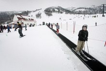 Rick Egan  |  Tribune file photo Young skiers ride on the