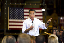 Republican presidential candidate, former Massachusetts Gov. Mitt Romney speaks at Charlotte Pipe and Foundry Company in Charlotte, N.C., Friday. Romney was to speak Saturday at Liberty University, a bastion of fundamentalist Christian education. (AP Photo/Jae C. Hong)
