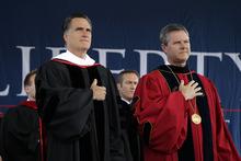 Republican presidential candidate, former Massachusetts Gov. Mitt Romney, left, and Jerry Falwell Jr., the chancellor of Liberty University, recite the pledge of alliance at the Liberty University in Lynchburg, Va, Saturday, May 12, 2012. (AP Photo/Jae C. Hong)