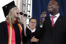 Republican presidential candidate, former Massachusetts Gov. Mitt Romney, listens to the national anthem before delivering a commencement address at the Liberty University in Lynchburg, Va,, Saturday, May 12, 2012. (AP Photo/Jae C. Hong)