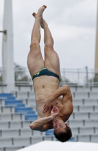 Ethan Warren, of Australia, performs during the men's three-meter springboard finals at the USA Diving Grand Prix in Fort Lauderdale, Fla., Sunday, May 13, 2012. (AP Photo/Alan Diaz)