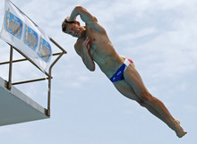 Christopher R. Colwill performs during the men's three-meter springboard finals at the USA Diving Grand Prix in Fort Lauderdale, Fla., Sunday, May 13, 2012. (AP Photo/Alan Diaz)