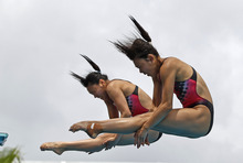Team China's Wang Han and Zheng Qulin perform during the women's 3-meter springboard synchronized finals at the USA Diving Grand Prix in Fort Lauderdale, Fla., Sunday, May 13, 2012. (AP Photo/Alan Diaz)