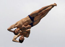 Saul Sanchez, foreground, and Ivan A. Garcia, of Mexico, perform during the men's 10-meter platform synchronized finals at the USA Diving Grand Prix in Fort Lauderdale, Fla., Sunday, May 13, 2012. (AP Photo/Alan Diaz)