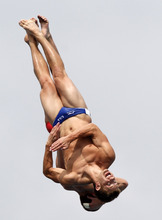 Logan E. Shinholser, foreground, and Ryan P. Hawkins perform during the men's 10-meter platform synchronized finals at the USA Diving Grand Prix diving competition in Fort Lauderdale, Fla., Sunday, May 13, 2012. (AP Photo/Alan Diaz)