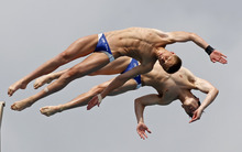 Steele A. Johnson, foreground, and Dashiell R. Enos, of the United States,  perform during the men's 10-meter platform synchronized finals at the USA Diving Grand Prix diving competition in Fort Lauderdale, Fla., Sunday, May 13, 2012. (AP Photo/Alan Diaz)