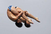 Chen Aisen, foreground, and Lian Huo, of China, perform during the men's 10-meter platform synchronized finals at the USA Diving Grand Prix diving competition in Fort Lauderdale, Fla., Sunday, May 13, 2012. (AP Photo/Alan Diaz)