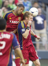 Real Salt Lake's Chris Schuler, left, collides with teammate Nat Borchers while going up for a header during the first half of play in a MLS soccer match, Saturday, May 12, 2012, in Seattle. (AP PHOTO/Stephen Brashear)