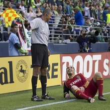 Real Salt Lake's Fabian Espíndola, right, jokes with Referee's Assitant Joe Fletcher during the second half of play in a MLS soccer match, Saturday, May 12, 2012, in Seattle. Real Salt Lake won the match 1-0. (AP PHOTO/Stephen Brashear)
