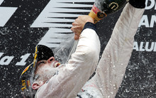Williams' Pastor Maldonado, from Venezuela sprays champagne after his victory after the Spanish  Grand Prix at  Montmelo, near Barcelona, Spain, Sunday, May 13, 2012. Maldonado become the sport's first Venezuelan winner, while Williams' 114th triumph was its first since the 2004 Brazilian GP.  (AP Photo/Manu Fernandez)