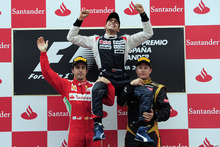 Williams's Pastor Maldonado, from Venezuela, centre, celebrates his victory lift by Ferrari's Fernando Alonso, from Spain, left, and Lotus's Kimi Raikkonen, from Finland, right after the Grand Prix  of Spain at  Montmelo racetrack near Barcelona, Spain, Sunday, May 13, 2012. Maldonado become the sport's first Venezuelan winner, while Williams' 114th triumph was its first since the 2004 Brazilian GP. (AP Photo/Manu Fernandez)