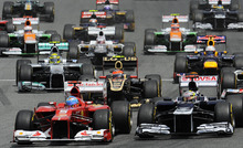 Ferrari Formula One driver, Fernando Alonso, from Spain, bottom left, leads the pack on the first corner during Spanish Grand Prix at the Montmelo racetrack near Barcelona, Sunday May 13, 2012. (AP Photo/Alvaro Barrientos)