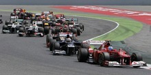 Ferrari's Fernando Alonso, from Spain,  front, leads after  the start of the Catalunya Grand Prix at Catalunya racetrack in Montmelo, near Barcelona, Spain, Sunday, May 13, 2012. (AP Photo/Andres Kudacki)