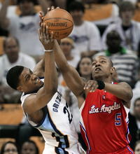 Memphis Grizzlies forward Rudy Gay (22) and Los Angeles Clippers forward Caron Butler (5) reach for a rebound in the first half of Game 7 in a first-round NBA basketball playoff series on Sunday, May 13, 2012, in Memphis, Tenn. (AP Photo/Mark Humphrey)