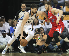 Memphis Grizzlies center Marc Gasol (33), of Spain, drives against Los Angeles Clippers forward Blake Griffin (32) in the first half of Game 7 in a first-round NBA basketball playoff series on Sunday, May 13, 2012, in Memphis, Tenn. (AP Photo/Mark Humphrey)