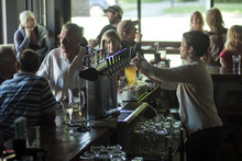 Chris Detrick  |  The Salt Lake Tribune Bartender Katie Selin pours a beer at Dick N' Dixie's Friday May 11, 2012.