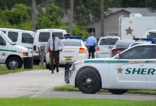 Emergency personell surround the scene of a multiple shooting in Port St. John, Brevard County, Fla., Tuesday, May 15, 2012. Sheriff's deputies in Brevard County said 33-year-old Tanya Thomas on Tuesday shot her four children, who ranged in age from 12 to 17, before shooting herself.   (AP Photo/Florida Today,Tim Shortt)   NO SALES, MAGS OUT