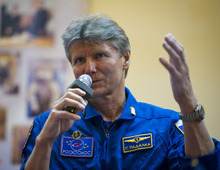 Quarantined Expedition 31 Soyuz Commander Gennady Padalka answers reporters questions from behind glass during a prelaunch press conference held at the Cosmonaut Hotel on Monday, May 14, 2012 in Baikonur, Kazakhstan. The launch of the Soyuz spacecraft with Padalka, Flight Engineer Sergei Revin of Russia, and prime NASA Flight Engineer Joe Acaba is scheduled for 9:01 a.m. local time on Tuesday, May 15. (AP Photo/NASA, Bill Ingalls)