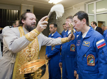 An Orthodox priest blesses the International Space Station crew members, from rear left, U.S. astronaut Joseph Acaba, and Russian cosmonauts Gennady Padalka and Sergei Revin, before leaving the hotel for final pre-launch preparation at the Baikonur Cosmodrome, in Baikonur, Kazakhstan, Monday, May 14, 2012.  (AP Photo/Sergei Remezov, Pool)