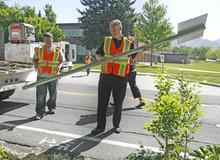 Rick Egan  | The Salt Lake Tribune  Salt Lake County Mayor Peter Corroon prepares to install a bike route sign near Evergreen Junior High on Monday.