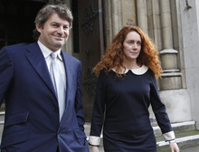 FILE This Friday, May 11, 2012 file photo shows Rebekah Brooks, former chief executive of News International and her husband Charlie Brooks leaving the High Court in London after giving evidence to the Leveson Inquiry. Brooks said Tuesday May 15, 2012 she and her husband will face charges over Britain's tabloid phone hacking scandal. Brooks, 43, said Tuesday in a statement that she will be prosecuted over allegations of obstruction of justice. (AP Photo/Sang Tan)
