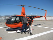 Robert Kirby and Utah Helicopter flight instructor Mindy Braithwaite pose in front of a Robinson R44 Raven II helicopter. Braithwaite gave Kirby a flying lesson on May 14.