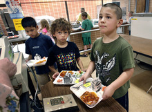 Scott Sommerdorf  |  The Salt Lake Tribune              At East Sandy Elementary, recess comes before lunch, a shift health officials are urging to help fight obesity. Ty Standiford stands in the front of the line for lunch checkout. Behind him to the left is Grae Moore, followed by Thomas Kolo.