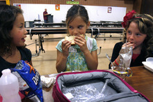 Scott Sommerdorf  |  The Salt Lake Tribune              At East Sandy Elementary, recess comes before lunch, a shift health officials are urging to help fight obesity. Malaya Bland, left, Allyson Romney and Libbie Duarte, right, eat their lunches after recess on Monday.